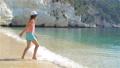 Adorable little girl during beach vacation having fun 54884249