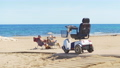 Electric wheelchair on the beach background the sea. 54898801