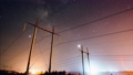 Incredible night sky with stars passing over power line,long exposure timelapse 54899978