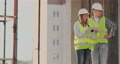 Portrait of construction engineers working on building site 54902393