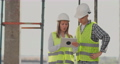 Construction site Team or architect and builder or worker with helmets discuss on a scaffold 54902399