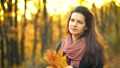 Young beautiful woman in autumn park 54953526
