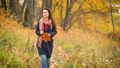 Young woman walking in autumn park 54953533