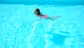 Adorable little girl swimming at outdoor swimming pool 54987816