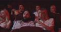 Couple disturbing cinema audience with talking 55015804