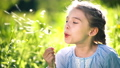 Beautiful little girl blowing dandelion at summer day. 55019521