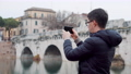 Man is photographing by smartphone bridge 55025670