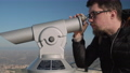 Tourist is looking inside observation telescope 55025672
