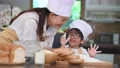 Cute little Asian boy with eyeglasses, chef hat an 55037190