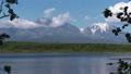 Active volcano, clouds drifting sky, alpine lake 55065093