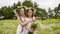 Couple Girls Laugh Friends Hug Flowers Meadow 55175419