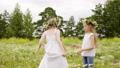 Girls Rotate Flowers Wreath Lawn Summer Holidays 55180611