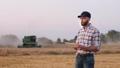 A male farmer uses a digital tablet in the field 55286854