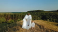 A girl with a child dressed as angels walk in nature 55289199