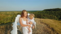 A girl with a child in her arms is dressed like angels 55292049