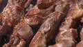 Pork barbecue cooking on metal skewers on grill 55374887