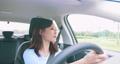 asian woman driving car 55439022