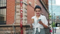 Portrait of attractive girl holding smartphone and take out coffee walking 55459248