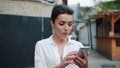 Excited adult woman looking at smartphone outdoors after getting great news 55459252