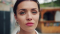 Slow motion portrait of young adult woman with serious face standing outdoors 55459262