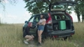 Female travelers checking out flat tyre on car 55465172