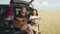 Joyful females with guitar enjoying music in car 55465248