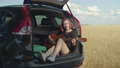 Dreamy hipster woman playing guitar in car trunk 55465263