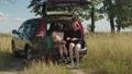 Positive tourist women relaxing in car trunk 55465275