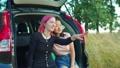 Happy diverse females admiring view on car trip 55486932