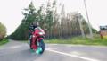 One biker rides on a road, wearing helmet. 55557231