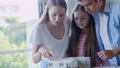 Family looks at the house model 55593464