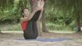 Asian woman practicing yoga 55593555