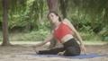 Asian woman practicing yoga 55593556