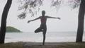 Asian woman practicing yoga 55593557