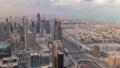 Dubai Downtown skyline futuristic cityscape with many skyscrapers and Burj Khalifa aerial timelapse. 55920953