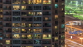 Lights in windows of modern multiple story building in urban setting at night timelapse 55931099