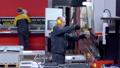 Worker operator bending metal sheet process by sheet bending machine for bus manufactuing part 56584073