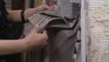 Female client in interior design studio looking at fabric samples 56605530