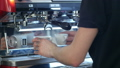 Professional espresso machine pouring strong looking fresh coffee into a neat ceramic cup 56618731
