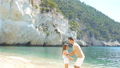 Beautiful father and daughter on Caribbean beach 56648877