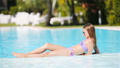 Little adorable girl in outdoor swimming pool 56648887