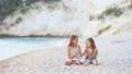Little girls having fun at tropical beach during summer vacation 56648911