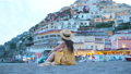 Summer holiday in Italy. Young woman in Positano village on the background, Amalfi Coast, Italy 56648913