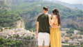 Summer holiday in Italy. Young couple in Positano village on the background, Amalfi Coast, Italy 56648916