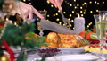 Woman carving roasted chicken on Christmas dinner 56655874