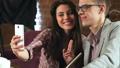 Elegant stylish couple smoking hookah and makes selfie on smartphone 56681408