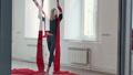 Beautiful pole dancer flying, using aerial silk in studio 56682092