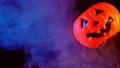 Halloween pumpkin lantern with multi color smoke 56701461
