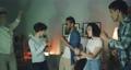 Happy friends men and women dancing having fun in dark apartment at night 56720881