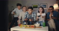 Multiracial group of students having fun with video game in dark apartment 56726209
